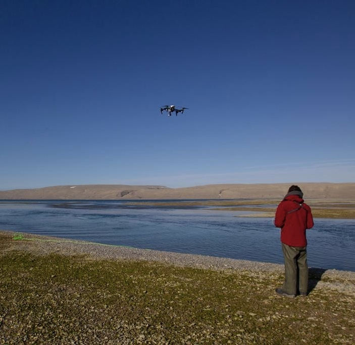 Nansen preparing to fly a drone over the belugas