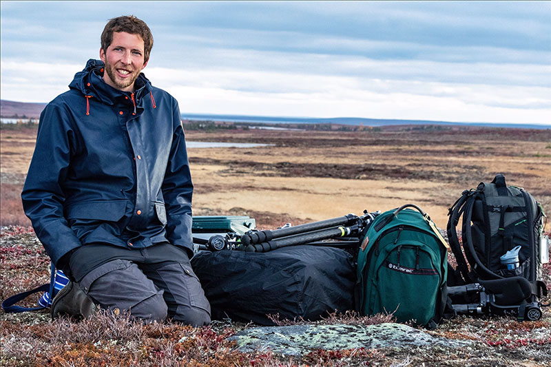 Nansen Weber on the tundra awaiting a helicopter pickup